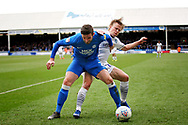Peterborough Utd defender Jason Naismith (2) is tackled by Wycombe forward Alex Samuel (25) during the EFL Sky Bet League 1 match between Peterborough United and Wycombe Wanderers at London Road, Peterborough, England on 2 March 2019.
