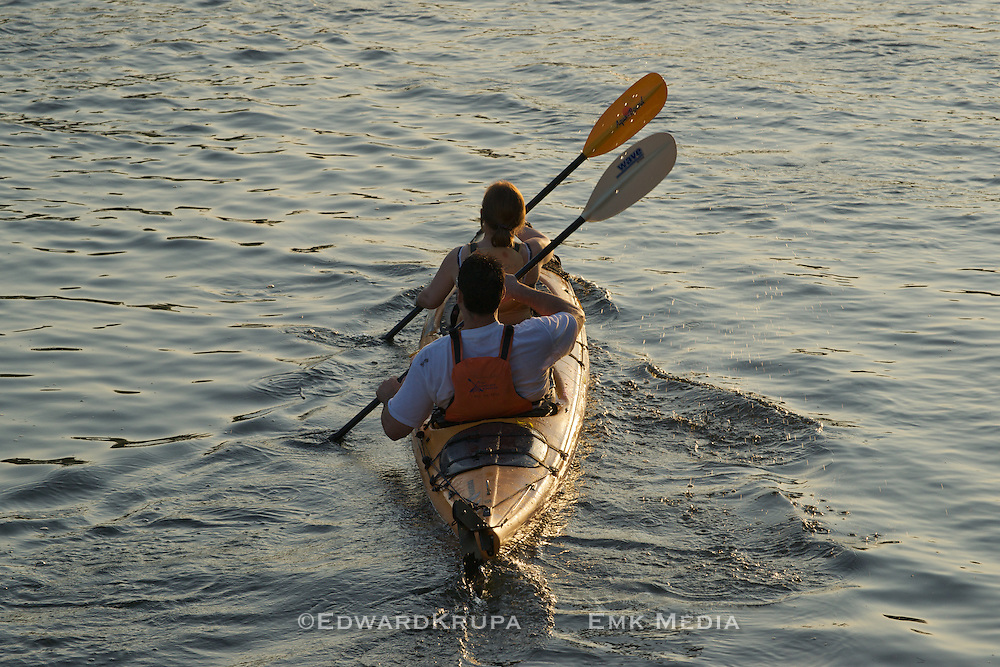 Couple paddling kayak. Toronto Island.