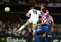 Photograph: Scott Heavey.<br />England  v Croatia, international. From Portman Road. 20/08.2003.<br />Michael Owen powers home a header from a David Beckham cross.