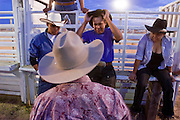 08 SEPTEMBER 2007 -- FT. DEFIANCE, AZ: A woman bullrider, right, gets some tips on riding bulls from more experienced men at the All Women Rodeo in the Dahozy Stampede Rodeo Arena in Ft. Defiance, AZ, on the Navajo Indian Reservation. It was the first all women's rodeo on the Navajo Indian Reservation.  Photo by Jack Kurtz/ZUMA Press