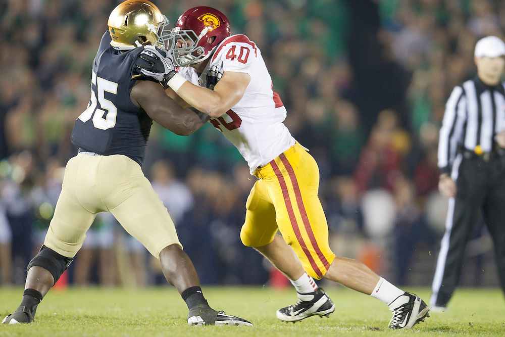 USC tight end Rhett Ellison (#40) blocks Notre Dame inside linebacker Prince Shembo (#55) during second quarter of NCAA football game between Notre Dame and USC.  The USC Trojans defeated the Notre Dame Fighting Irish 31-17 in game at Notre Dame Stadium in South Bend, Indiana.