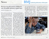 Boy with Mobile Phone / British Medical Journal / January 2005