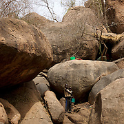 Children stand outside a cave used as shelter against bombardments by Sudan's Army Forces airplanes near the Nuba village of Tess in South Kordofan.