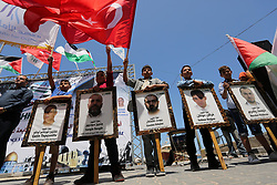 May 31, 2017 - Gaza City, Gaza Strip - Palestinian children hold the Palestinian and Turkish flags and picture of activists who was dead by Israeli forces during a rally to mark the 7th anniversary of the Mavi Marmara Gaza flotilla incident, at the seaport of Gaza City. Nine activists, eight Turkish and one Turkish-American, died on May 31, 2010, when Israeli commandos raided the Mavi Marmara ship, which was part of a flotilla seeking to break the blockade imposed on the Gaza Strip  (Credit Image: © Ashraf Amra/APA Images via ZUMA Wire)