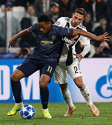 November 8, 2018 - Turin, Italy - Mattia De Sciglio (R) of Juventus and Anthony Martial of Manchester United vie for the ball during the Group H match of the UEFA Champions League between Juventus FC and Manchester United FC on November 7, 2018 at Juventus Stadium in Turin, Italy. (Credit Image: © Mike Kireev/NurPhoto via ZUMA Press)