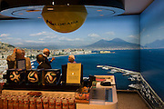 Duty Free customer and a picture of the Bay of Naples at Naples airport.