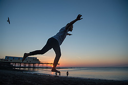 © Licensed to London News Pictures. Aberystwyth Wales UK, Wednesday 10 October 2018<br /> <br /> UK Weather: A man slack-lining on a glorious, and unusually warm,  autumn evening at the seaside in Aberystwyth on the west wales coast, after a day of exceptionally warm sunshine for much of the UK, with temperatures reaching the 20's celsius. The weather is set to change dramatically on Friday and Saturday however, with a band of torrential rain bringing the risk of flooding to much of Wales and North West  England<br /> Photo  credit: Keith Morris / LNP