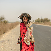 She looked confused, one trembling hand on her mouth. I wanted to talk to her, make her feel comfortable. She mumbled, avoiding eye contact. I can only try and imagine her life. I felt sad I couldn't fully reach out to her.<br /> Uttar Pradesh Province.