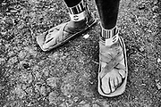 Traditional sandals made from rubber tires worn by the Maasai tribe, black and white ,Amboseli, Kenya, Africa