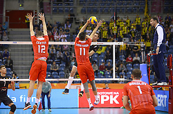 December 16, 2017 - Krakow, Malopolska, Poland - Micah Christenson (11) and Enrico Cester (12) of Lube Civitanova in action against   one of SKRA Belchatow during the match between Lube Civitanova and SKRA Belchatow during the semi finals of Volleyball Men's Club World Championship 2017 in Tauron Arena. (Credit Image: © Omar Marques/SOPA via ZUMA Wire)