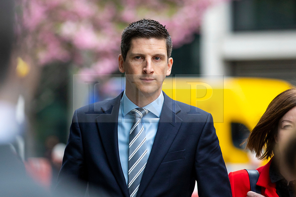 © Licensed to London News Pictures. 23/04/2018. London, UK. BBC Reporter Dan Johnson arrives at the Rolls Building of the High Court in London where Sir Cliff Richard is claiming damages against the BBC for loss of earnings. The 77-year-old singer is suing the corporation after his home in Sunningdale, Berkshire was raided following allegations of sexual assault made to Metropolitan Police. Photo credit: Rob Pinney/LNP
