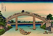 Seen Through the Mannenbashi. From 'Thirty-six Views of Mount Fuji', c1831. Katsushika Hokusai (1760-1849) Japanese  Ukiyo-e artist.  Bridge Onaki River Pedestrian Boat Fishermen Edo Tokyo Japan