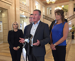 Sinn Fein's Conor Murphy, surrounded by party colleagues, talking to media in Parliament Buildings, Stormont.