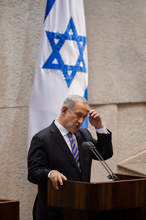 Israel's Prime Minister Benjamin Netanyahu gestures as he speaks, during a memorial session marking 18 years since the assassination of former Israeli Prime Minister Yitzhak Rabin, at the Knesset, Israel's Parliament in Jerusalem, on October 16, 2013.