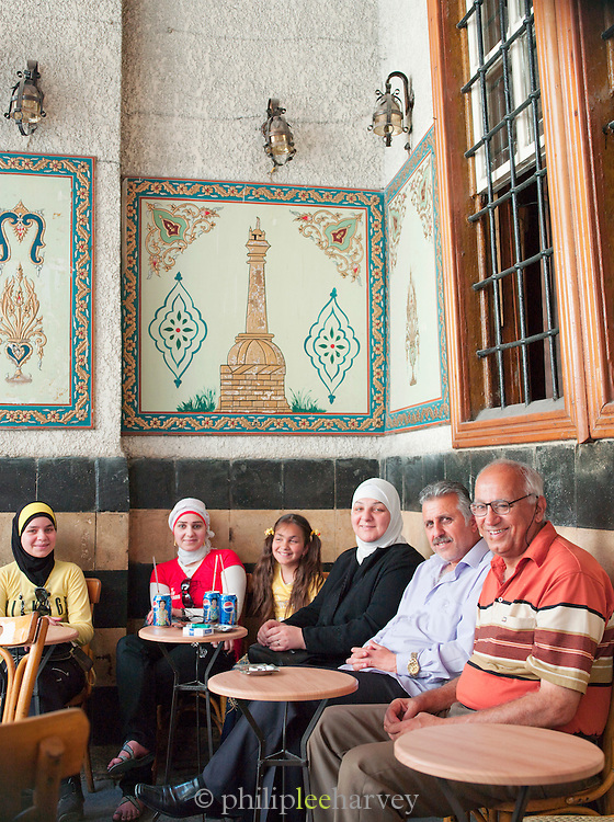 People sit relaxing in a cafe in the morning in the Old City, Damascus, Syria