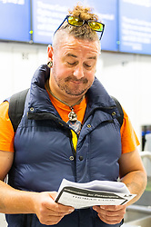 """Feeling """"abandoned"""", James Edgerton-Stanbridge, 45, travelling with his partner Kim, 60, who were bound for a Red Sea holiday in Egypt, at the Thomas Cook Check-in after the travel company ceased trading after failing to come to a deal with its bankers and creditors, leaving tens of thousands of travellers unable to depart on their holidays from South Terminal at Gatwick Airport, and a massive repatriation exercise to return holidaymakers from destinations all over the world. London Gatwick Airport, September 23 2019."""