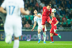 Jan Bednarek of Poland and Andraž Šporar of Slovenia during the 2020 UEFA European Championships group G qualifying match between Slovenia and Poland at SRC Stozice on September 6, 2019 in Ljubljana, Slovenia. Photo by Grega Valancic / Sportida