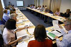 Group of employees at an NHS teamwork meeting,