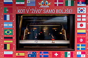 "Dance is shown on a street TV screen bordered by international flags between games during the 2018 World Cup in Russia, in the Slovenian capital, Ljubljana, on 25th June 2018, in Ljubljana, Slovenia. Above the screen it reads: ""Just like in the living room just better."""