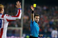 Atletico de Madrid´s Fernando Torres receives a yellow card during the UEFA Champions League round of 16 second leg match between Atletico de Madrid and Bayer 04 Leverkusen at Vicente Calderon stadium in Madrid, Spain. March 17, 2015. (ALTERPHOTOS/Victor Blanco)