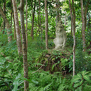 Buddhist statue in the gardens of Sacred Monkey Forest Sanctuary, Ubud, Indonesia.
