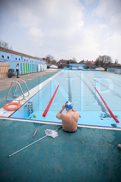 © London News Pictures. 28/03/12. Local former Paralympian medal winner James Muirhead, who lost his sight at 17, prepares himself for training in the 50m Olympic sized pool. James is a former Paralympian winning 5 golds, 8 silvers and 3 bronze medals in the late 1970's and early 1980's. Charlton Lido in South London, opens today 28/03/13 after extensive refurbishment work to the heated Olympic sized outdoor pool in Charlton, London, England. Picture credit should read Manu Palomeque/LNP
