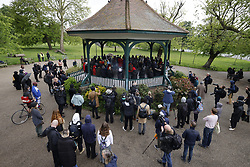 © Licensed to London News Pictures. 24/05/2021. London, UK. Relatives and friends gather for a vigil at Ruskin Park bandstand for shot Black Lives matter activist Sasha Johnson near King's Collge Hospital in south London. Police continue to look for clues at Consort Road in nearby Peckham after Ms Johnson was shot at 3am on Sunday morning and is undergoing treatment in hospital. Photo credit: Peter Macdiarmid/LNP