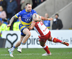 Warrington Wolves' Blake Austin is tackled by Hull Kingston Rovers' Weller Hauraki during the Betfred Super League match at the Halliwell Jones Stadium, Warrington.