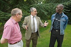 Group of men chatting in a park,