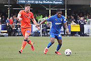 AFC Wimbledon attacker Michael Folivi (41) taking on Millwall defender Ryan Leonard (28) during the The FA Cup 5th round match between AFC Wimbledon and Millwall at the Cherry Red Records Stadium, Kingston, England on 16 February 2019.