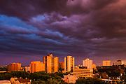 Saskatoon skyline, stormy evening sunset. This image makes outstanding wall decor as a metal print.