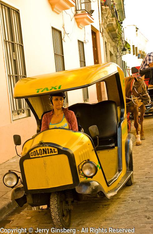 Motor scooter taxi in Old Havana, Havana Vieja, Habana Vieja, Cuba.