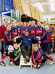 Aston Juniors Under 13s Football club, attempt to get Wickes Canklow Meadows store manager Eddie Fitzpatrick to join them in a game.<br />COPYRIGHT PAUL DAVID DRABBLE