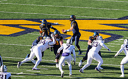 Nov 10, 2018; Morgantown, WV, USA; West Virginia Mountaineers quarterback Will Grier (7) drops back to pass during the third quarter against the TCU Horned Frogs at Mountaineer Field at Milan Puskar Stadium. Mandatory Credit: Ben Queen-USA TODAY Sports