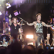 """WASHINGTON, DC - July 25, 2014 - Tyler Hubbard and Brian Kelley of Florida Georgia Line perform at Nationals Park in Washington, D.C. as part of Jason Aldean's Burn It Down Tour. The duo have had multiple singles top the US Country charts, including """"Cruise"""" and """"This is How We Roll."""" (Photo by Kyle Gustafson / For The Washington Post)"""