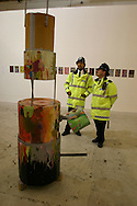 LIVERPOOL, ENGLAND, UNITED KINGDOM: Two police officers get a sneak preview of sculptures, paintings, photographs and intsallations in the New Contemporaries section of the 3rd Liverpool Biennial, the UK's largest contemporary arts event which commences on September 18, 2004 and runs until November. This year's festival has taken over derelict warehouse space near the Albert Dock and transformed them into a series of gallery spaces...Photograph © Colin McPherson, 16/09/04..Tel. +44 (0)7831 838717..Email: cmc1964@aol.com