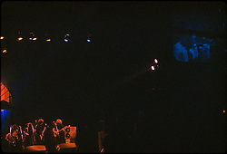 Band & Stage lower left, Video Screen upper right. Jerry Garcia Band at the Capitol Theater, Passaic  NJ 11-26-77. From an original Kodak Ektachrome Professional Tungsten Film Slide, EPT160.