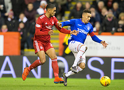 Rangers James Tavernier (right) and Aberdeen's Max Lowe (left) during the Ladbrokes Scottish Premiership match at Pittodrie Stadium, Aberdeen.