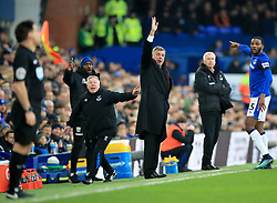 Everton manager Sam Allardyce (centre) and assistant Sammy Lee (left) appeal from the touchline during the Premier League match at Goodison Park, Liverpool.