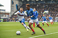 Portsmouth Midfielder, Jamal Lowe (10) takes on Rochdale Defender, Ryan McLaughlin (2) during the EFL Sky Bet League 1 match between Portsmouth and Rochdale at Fratton Park, Portsmouth, England on 13 April 2019.