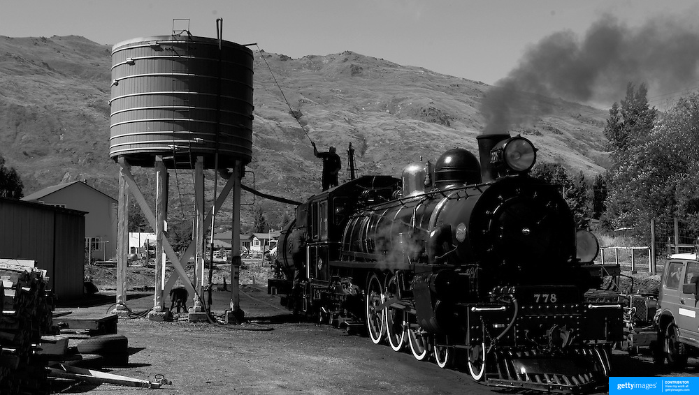 The Kingston Flyer steam train refuels at Kingston, South Island, New Zealand...You would be forgiven for thinking you'd just stepped out of a time machine while travelling around the South Island of New Zealand.. From the misty shades of grey in the fiord of Doubtful Sound, to the fully operational Steamboat the TSS Earnslaw; the Lady of the Lake on Lake Wakitepo, this beautiful island is a Tardis for tourists!..The South Island of New Zealand is roughly the size of England, but it's population of less than a million people means much of the land remains free from human development. It's breathtaking views, and it's climate, could be likened to a cross between Scotland and Scandinavia, and around every corner is mostly unspoilt natural beauty....The Commercialised resort town of Queenstown is the nerve centre of the islands tourism industry, providing the more adventurous thrill seeker with jet boating, skydiving, bungy jumping, and paragliding to name just a few of the more adventurous activities..Queenstown also provides numerous Lord of the Rings tours into middle earth.. In stark contrast the TSS Earnslaw, The Vintage Steamship which has graced the waters of Lake Wakatipu since 1912 provides daily voyages to Walters Peak and a step back in time for it's passengers. The voyage even includes a good old fashion sing-a-long to songs of yesteryear...Just forty five minutes out of Queenstown the Kingston Flyer, a vintage steam train still operates on 14km of track using two AB Pacific Class steam locomotives built in 1925 and 1927 respectively, although the Flyer's history began much earlier in 1878 when it operated between the main south line and Gore..Fijordland on the south Western side of the Island has some of the world's greatest treks; indeed the Milford Track is often booked up way in advance...