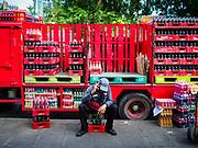 07 NOVEMBER 2017 - BANGKOK, THAILAND: A Coca Cola delivery man at a local market on Ekkamai Soi 30 in Bangkok.      PHOTO BY JACK KURTZ
