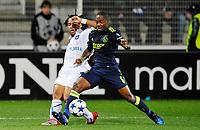 FOOTBALL - CHAMPIONS LEAGUE 2010/2011 - GROUP STAGE - GROUP G - AJ AUXERRE v AJAX AMSTERDAM - 3/11/2010 - PHOTO GUY JEFFROY / DPPI - ROY CONTOUT (AUX) / EYONG ENOH (AJAX)
