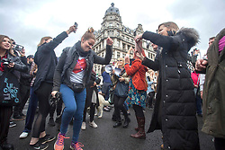 © Licensed to London News Pictures. 24/10/2020. London, UK. Anti-mask and lockdown protestors are seen dancing at Parliament Square during a United for Freedom demonstration in central London. Photo credit: Marcin Nowak/LNP