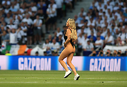 A pitch invader interrupts play during the UEFA Champions League Final at the Wanda Metropolitano, Madrid.