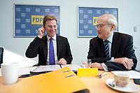 22 FEB 2010, BERLIN/GERMANY:<br /> Guido Westerwelle (L), FDP Bundesvorsitzender und Bundesaussenminister, und Rainer Bruederle (R), FDP, Bundeswirtschaftsminister, im Gespraech, vor Beginn einer Sitzung des FDP Praesidiums, Thomas-Dehler-Haus<br /> IMAGE: 20100222-01-013<br /> KEYWORDS: Rainer Brüderle, Gespräch