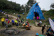 Hikers and porters occupy a camp located at 2,200m up Mt. Fansipan along Tram Ton route, Lao Cai Province, Vietnam, Southeast Asia