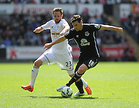 Swansea City's Gylfi Sigur?sson vies for possession with Everton's Gareth Barry<br /> <br /> Photographer Ashley Crowden/CameraSport<br /> <br /> Football - Barclays Premiership - Swansea City v  Everton - Saturday 11th April 2015 - Liberty Stadium - Swansea<br /> <br /> © CameraSport - 43 Linden Ave. Countesthorpe. Leicester. England. LE8 5PG - Tel: +44 (0) 116 277 4147 - admin@camerasport.com - www.camerasport.com