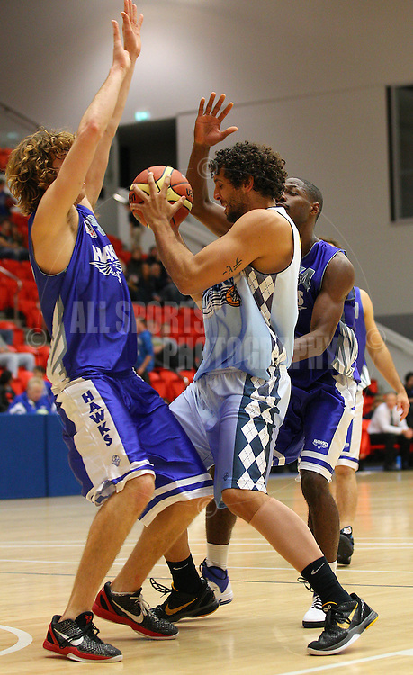 PERTH, AUSTRALIA - JULY 16: Matt Knight of the Tigers is blocked by Joshua Garlepp and Anthony Lee of the Hawks during the week 18 SBL game between the Perry Lakes Hawks and the Willetton TIgers at The State Basketball Center on July 16, 2011 in Perth, Australia.  (Photo by Paul Kane/Allsports Photography)