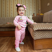 CAPTION: With a big grin, Stella enjoys her newly-found mobility. LOCATION: Volgograd, Russia. INDIVIDUAL(S) PHOTOGRAPHED: Stella Aharonyan.